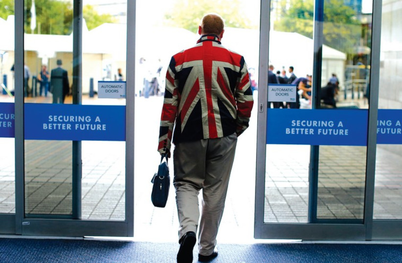 A MAN leaves the Conservative Party convention last month in the UK. (photo credit: REUTERS)