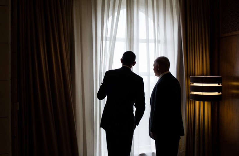 President Barack Obama and Israeli Prime Minister Benjamin Netanyahu look out a window before their lunch at the King David Hotel in Jerusalem (photo credit: OFFICIAL WHITE HOUSE PHOTO / PETE SOUZA)