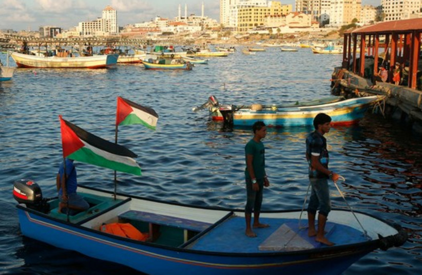 Palestinians stand atop a boat at Gaza's seaport in Gaza City October 16 (photo credit: REUTERS)