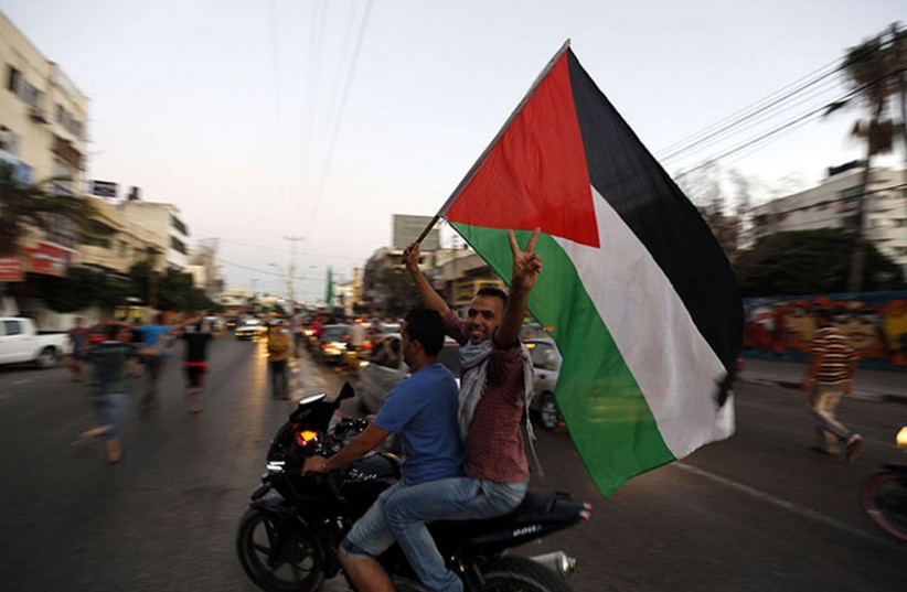 Palestinians in Gaza celebrate cease-fire (photo credit: REUTERS)