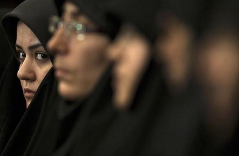 An Iranian woman attends a religious conference in Tehran (photo credit: REUTERS)