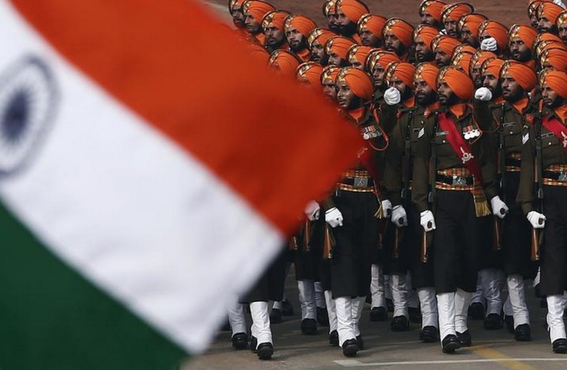 Indian Army soldiers march during the Republic Day parade in New Delhi (photo credit: REUTERS)