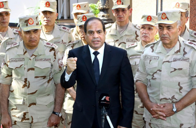 Egyptian President Abdel Fattah al-Sisi gives a speech outside the Supreme Council in Cairo  (photo credit: REUTERS)
