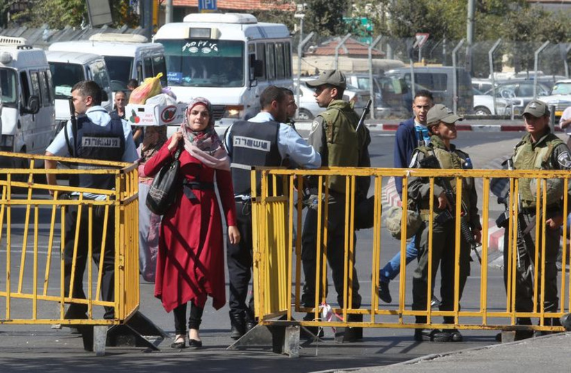 Police and Palestinians at Damascus Gate (photo credit: MARC ISRAEL SELLEM/THE JERUSALEM POST)