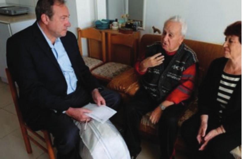 IFCJ FOUNDER and president Rabbi Yechiel Eckstein visits the elderly in Ashdod. (photo credit: Oren Nahshon)