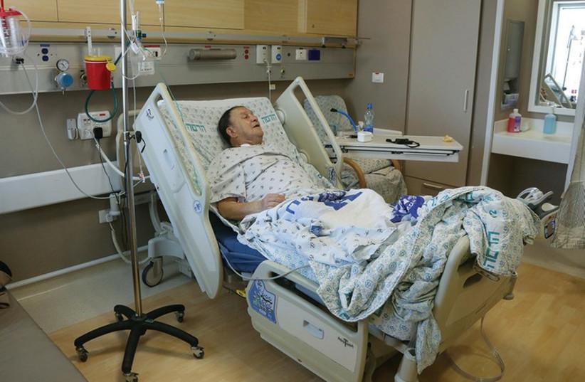 Man lying in a hospital bed at Hadassah University Medical Center in Jerusalem's Ein Kerem [illustrative]. (photo credit: MARC ISRAEL SELLEM/THE JERUSALEM POST)
