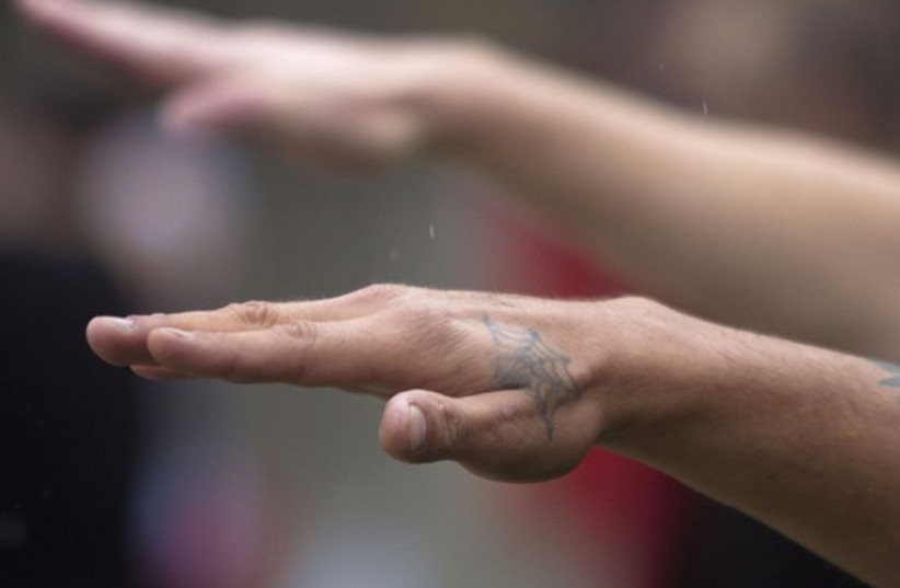 Man gives Nazi salute  (photo credit: REUTERS)