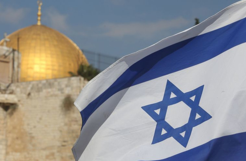 Dome of the rock and Israeli flag (photo credit: MARC ISRAEL SELLEM/THE JERUSALEM POST)