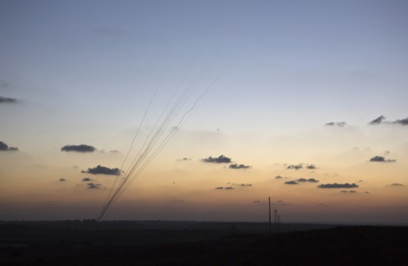Smoke trails are seen as rockets are launched towards Israel from the northern Gaza Strip (photo credit: REUTERS)