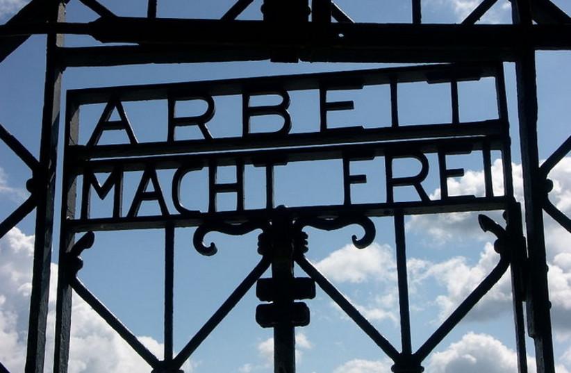 'Arbeit Macht Frei' sign at Dachau (photo credit: Wikimedia Commons)