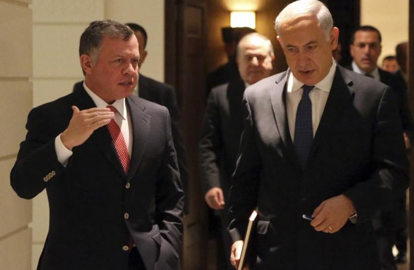 Jordan's King Abdullah walks with Prime Minister Benjamin Netanyahu (photo credit: REUTERS)