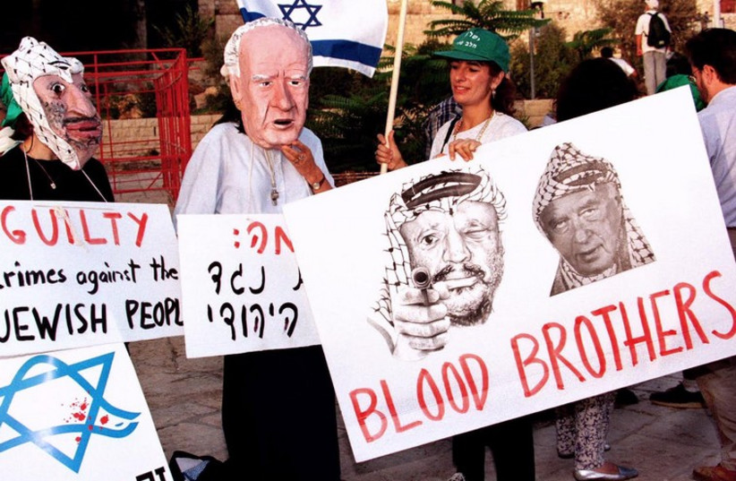 """This poster calls both Rabin and PLO then-chairman Arafat """"blood brothers"""" (photo credit: REUTERS)"""