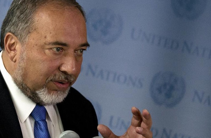 Foreign Minister Avigdor Liberman speaks to the press at the United Nations General Assembly (photo credit: REUTERS)