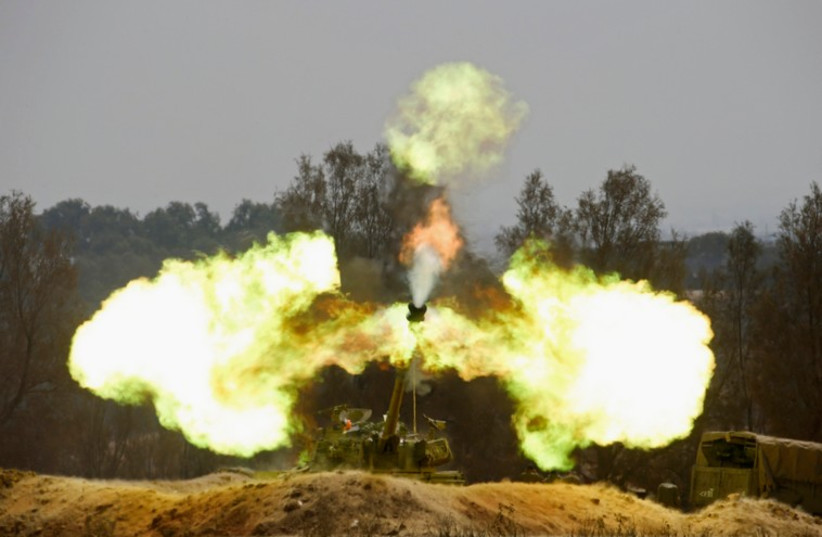 An Israeli mobile artillery unit fires towards southern Gaza on August 1, 2014 (photo credit: REUTERS)
