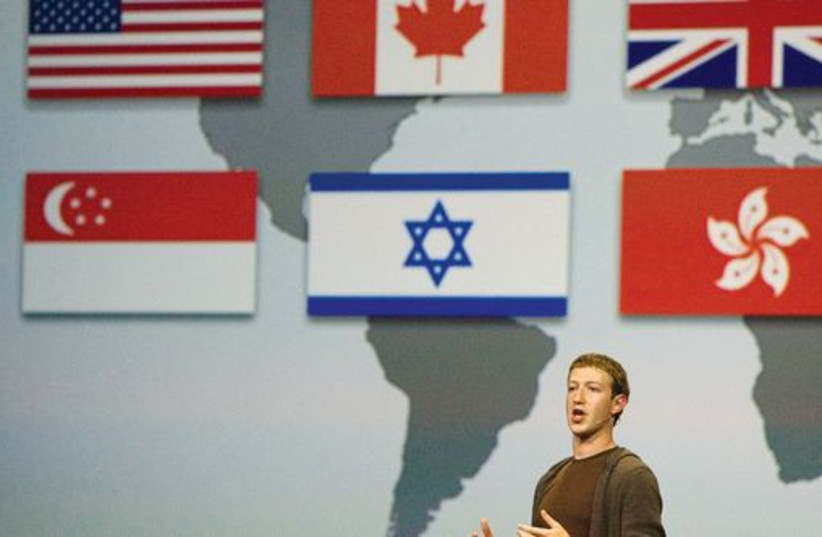 Mark Zuckerberg, founder and CEO of Facebook, at the company's annual conference in San Francisco in 2008. (photo credit: REUTERS)