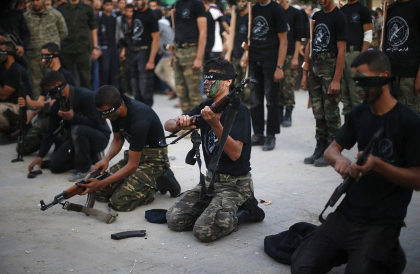 Hamas youth popular army (photo credit: REUTERS)