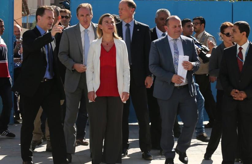 EU foreign policy chief Federica Mogherini (C) visits a UN-run school in Gaza. (photo credit: REUTERS)