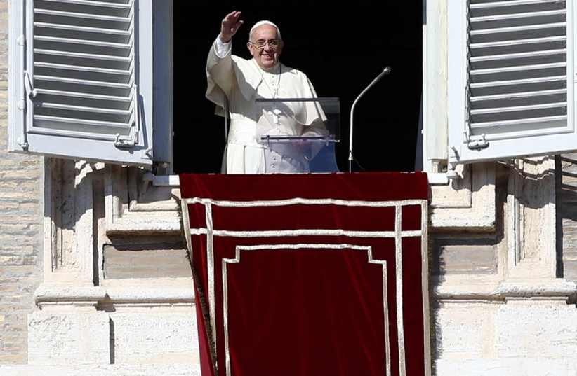 Pope Francis waves during his Sunday Angelus prayer in Saint Peter's Square at the Vatican (photo credit: REUTERS)