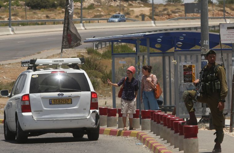 Hitch hiking in Gush Etzion (photo credit: MARC ISRAEL SELLEM/THE JERUSALEM POST)