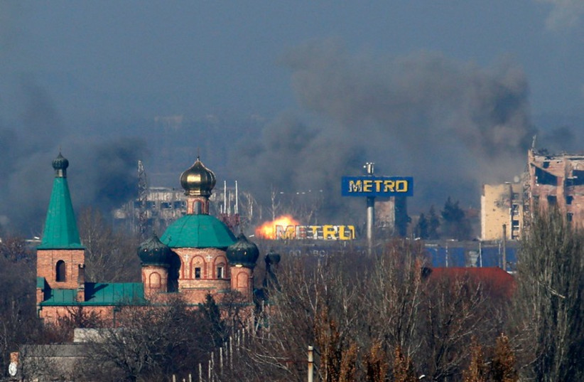 Smoke rises above an old terminal (L) and an administrative building of the Sergey Prokofiev International Airport after the recent shelling during fighting between pro-Russian separatists and Ukrainian government forces in Donetsk, eastern Ukraine, November 9, 2014. (photo credit: REUTERS)