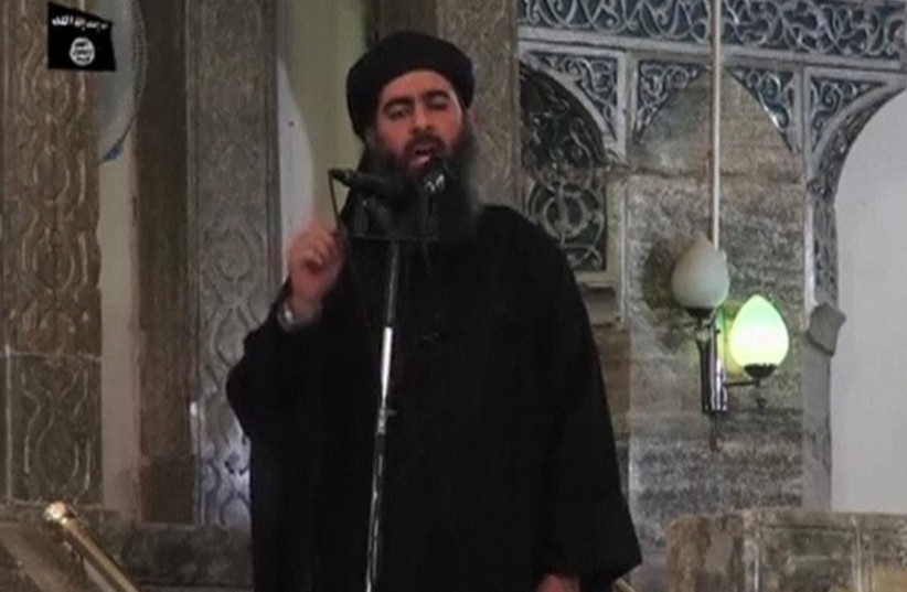 A man purported to be the reclusive leader of the militant Islamic State Abu Bakr al Baghdadi made a rare public appearance at a mosque in the center of Mosul, on July 5, 2014. (photo credit: REUTERS)