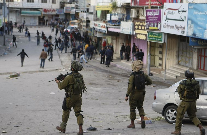 IDF soldiers in Hebron (photo credit: REUTERS)