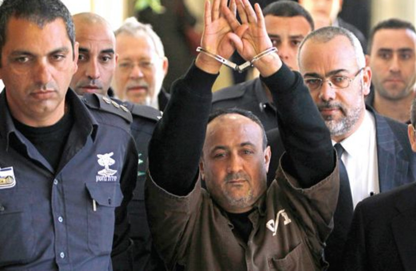 Jailed Fatah leader Marwan Barghouti would win elections for Palestinian president according to a poll held in early summer by the Palestinian Center for Public Opinion. (photo credit: REUTERS/BAZ RATNER)