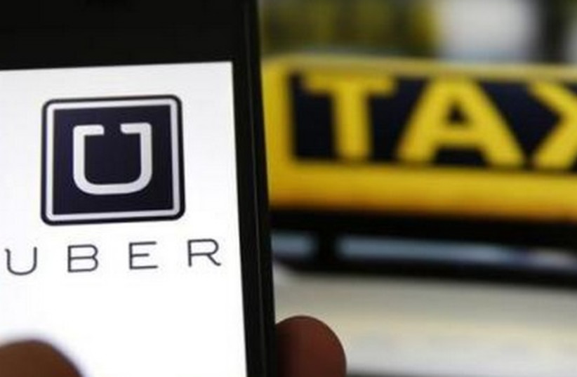 Uber (photo credit: REUTERS)