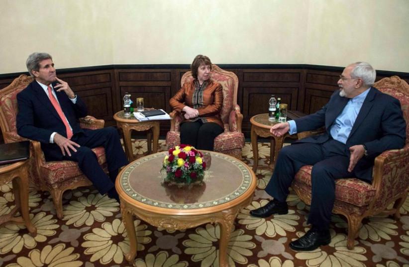US Secretary of State John Kerry, EU envoy Catherine Ashton, Iranian Foreign Minister Mohammad Javad Zarif meet in Muscat November 10 (photo credit: REUTERS)