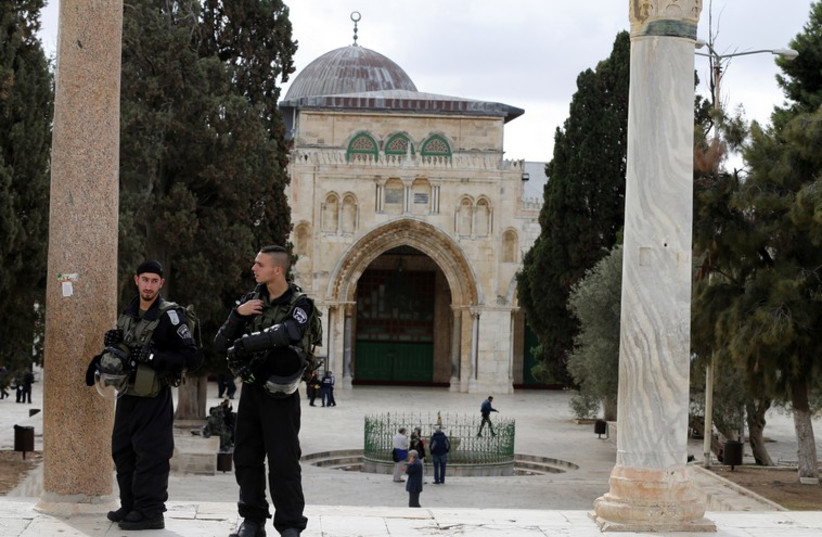 Israeli police officers stand guard on the Temple Mount  compound in Jerusalem's Old City (photo credit: REUTERS)