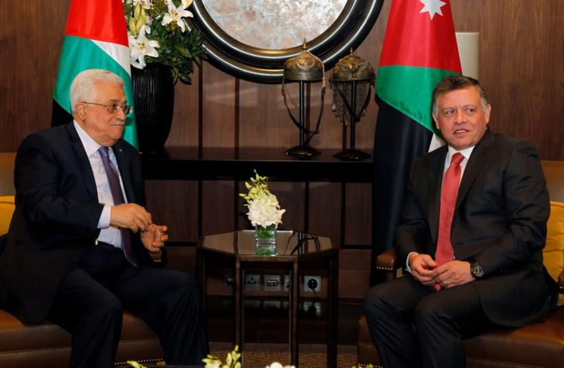 Jordan's King Abdullah meets with Palestinian Authority President Mahmoud Abbas at the Royal Palace in Amman November 12 (photo credit: REUTERS)