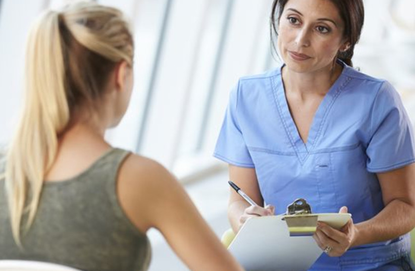A women speaks to a nurse (illustrative photo) (photo credit: INGIMAGE)