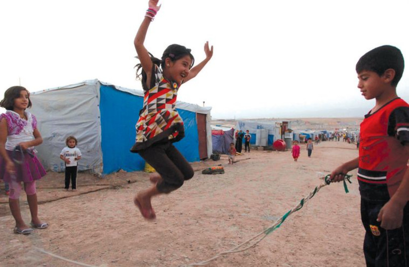 Syrian refugee children play at the Domiz refugee camp in the northern Iraqi- Kurdistan province of Dohuk, on September 3, 2013. (photo credit: REUTERS)