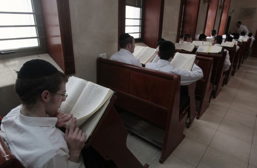 Ultra-Orthodox Jewish youths study religious texts at a synagogue in Jerusalem April 7, 2011. (photo credit: REUTERS)