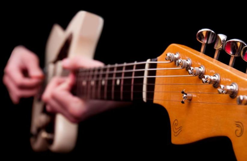 Guitar player (illustrative photo) (photo credit: INGIMAGE)