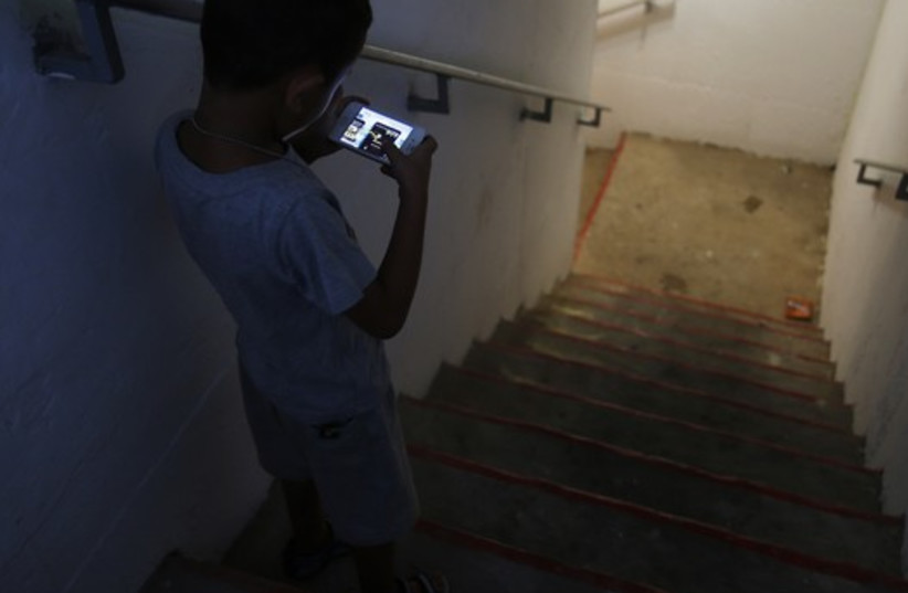 Cell phone in rocket shelter (photo credit: REUTERS)
