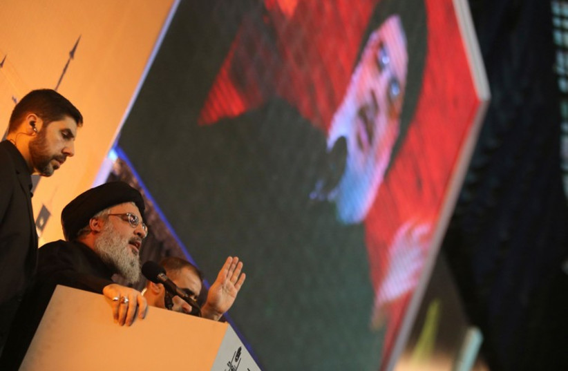 Hezbollah leader Hassan Nasrallah addresses his supporters during a rare public appearance in Beirut, November 3 (photo credit: REUTERS)