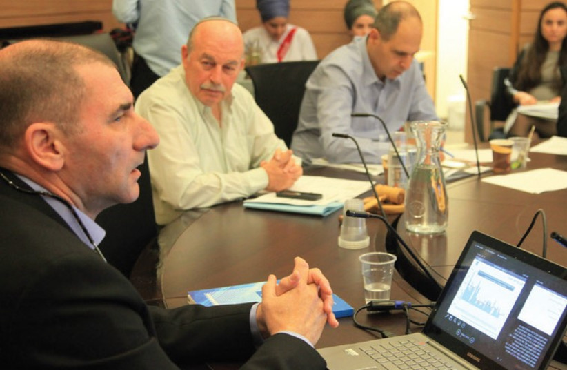 Finance Ministry chief economist Yoel Naveh (left) speaks to the Knesset Finance Committee in Jerusalem (photo credit: KNESSET)