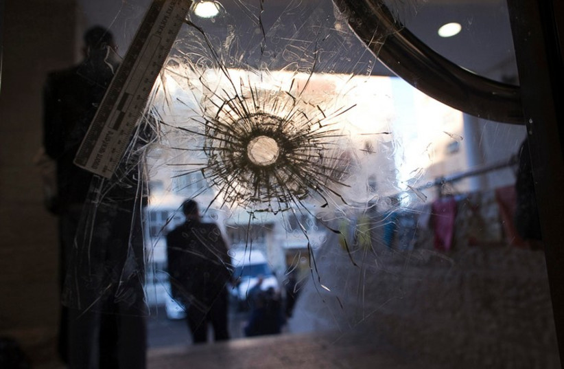 A bullet hole in a door of the Jerusalem synagogue where two Palestinian terrorists killed four rabbis and a police officer, November 19, 2014 (photo credit: REUTERS)