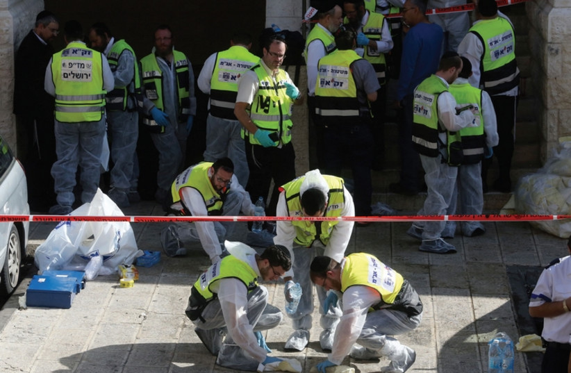 Terror attack scene in Jerusalem  (photo credit: MARC ISRAEL SELLEM/THE JERUSALEM POST)