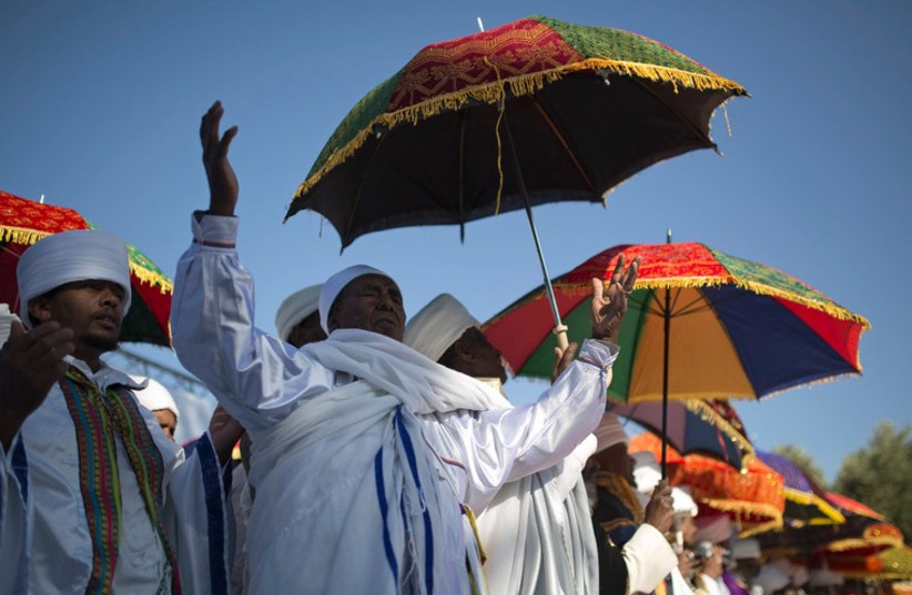 Members of the Ethiopian Jewish community in Israel mark the holiday of Sigd in Jerusalem November 20, 2014 (photo credit: REUTERS/AMIR COHEN)