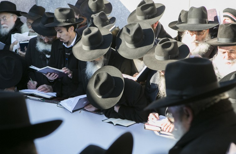 Rabbis pray at the gravesite of the Lubavitcher Rebbe, Rabbi Menachem M. Schneerson (photo credit: ADAM BEN COHEN / CHABAD.ORG)