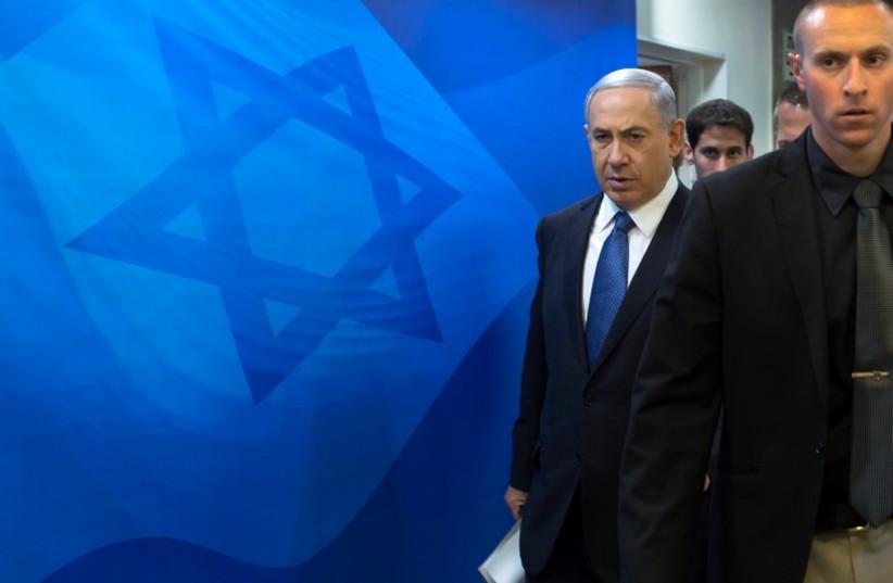 Prime Minister Benjamin Netanyahu arrives to the weekly cabinet meeting in Jerusalem November 23 (photo credit: REUTERS)