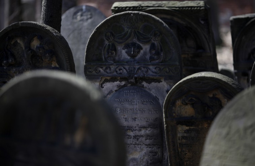 Old gravestones are pictured at the Jewish Cemetery in Warsaw (file) (photo credit: REUTERS)
