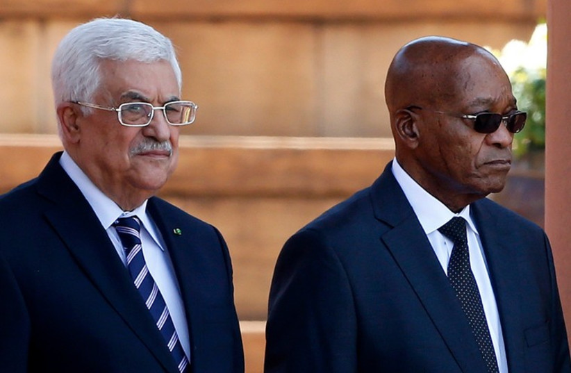 Palestinian Authority President Mahmoud Abbas (L) stands with South Africa's President Jacob Zuma at the Union Building in Pretoria November 26, 2014. (photo credit: REUTERS)