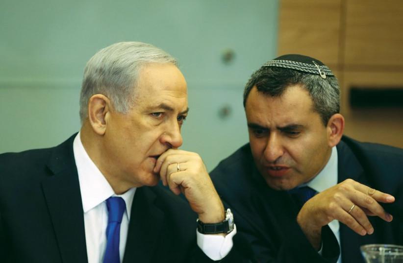 Prime Minister Benjamin Netanyahu listens to Zeev Elkin during a committee meeting at the Knesset in Jerusalem in June. (photo credit: REUTERS)