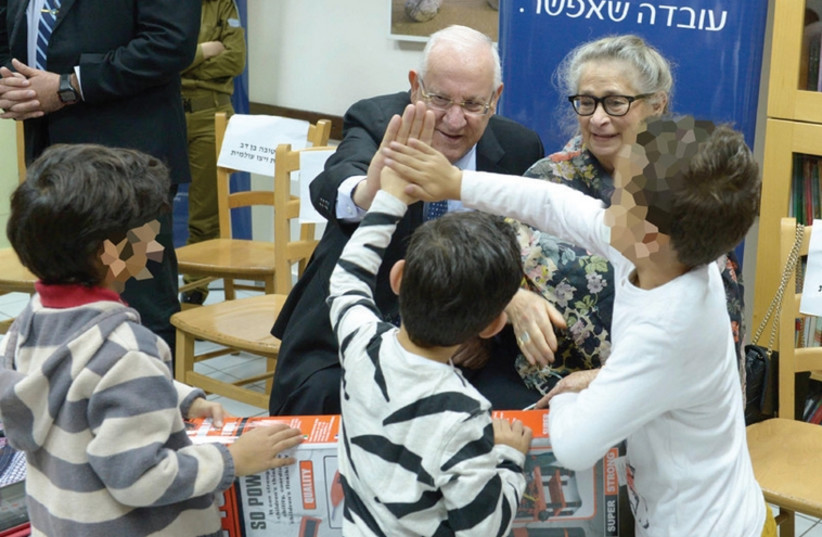 Reuven and Nechama Rivlin with children at the WIZO shelter. (photo credit: Mark Neiman/GPO)