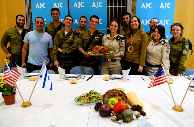 AJC's lone soldier Thanksgiving feast (photo credit: SHAY WAGNER)