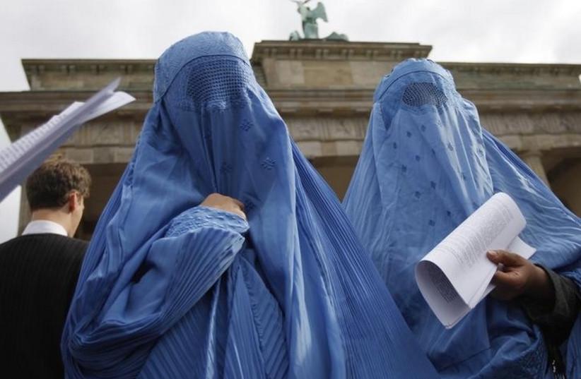 Women dressed in traditional burqa garments in Berlin (photo credit: REUTERS)