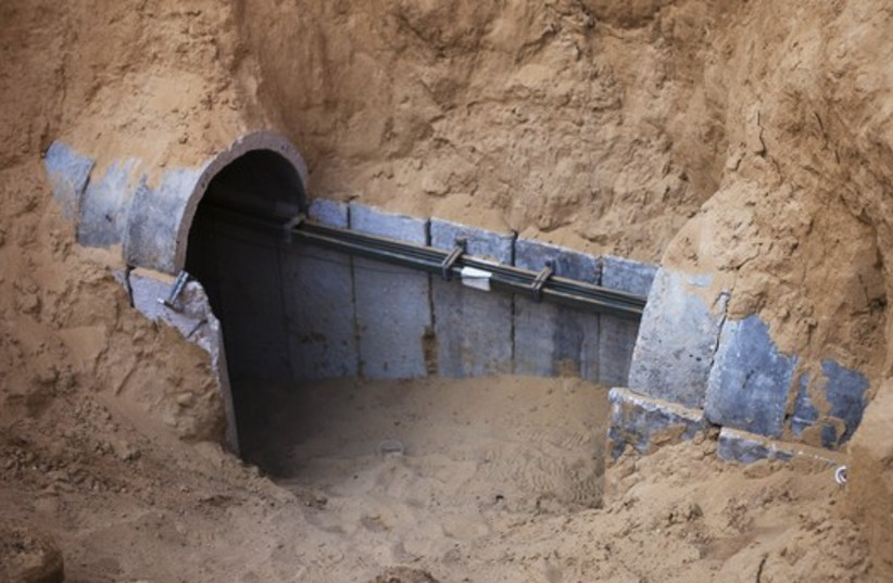 The entrance to a tunnel exposed by the Israeli military is seen on the Israeli side of the Israel-Gaza border (photo credit: REUTERS)